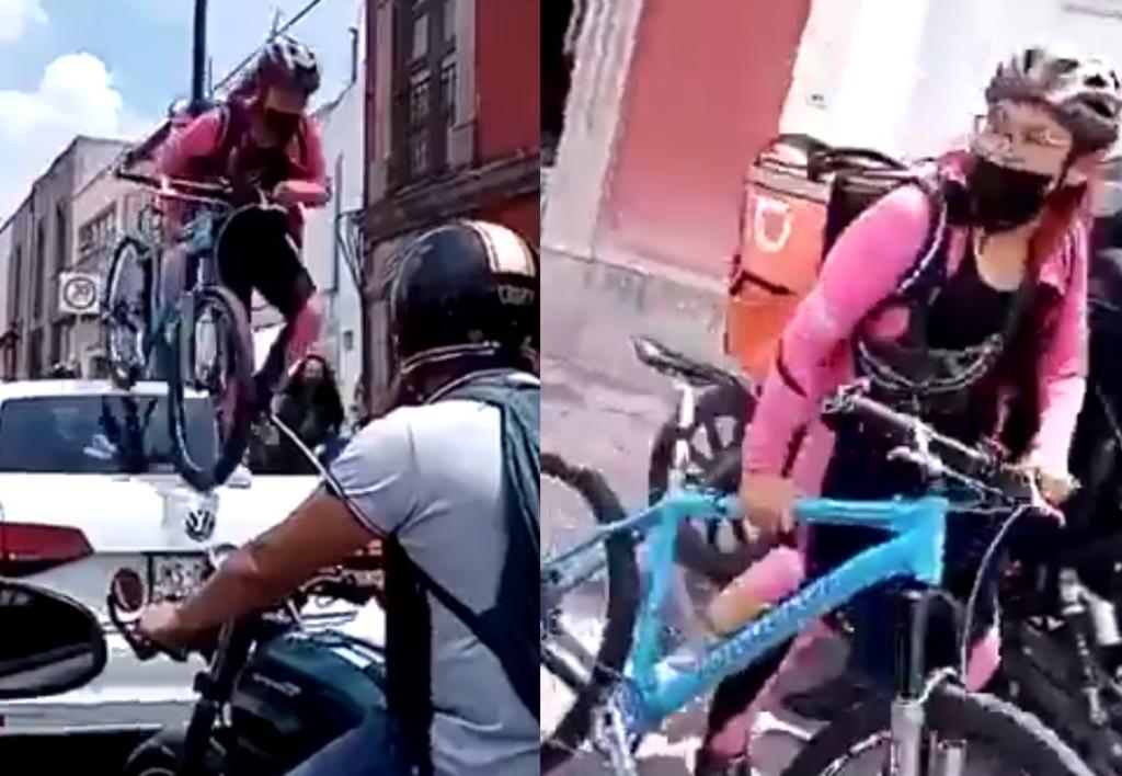 Repartidora de comida pasa encima de automóvil que no respetó ciclovía en Querétaro