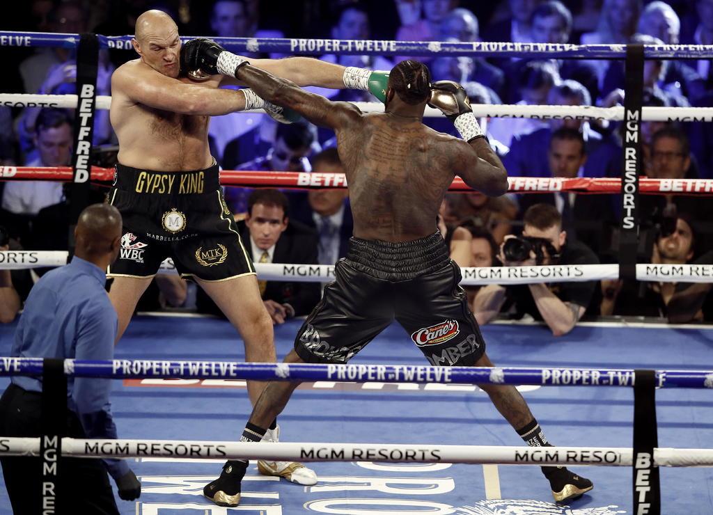 Tyson Fury vs. Deontay Wilder III se pospone por COVID-19